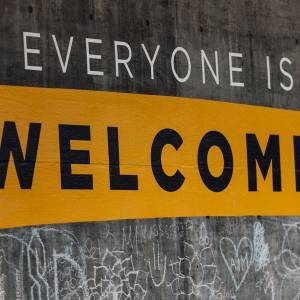 Sign painted on wall that reads: Everyone is Welcome