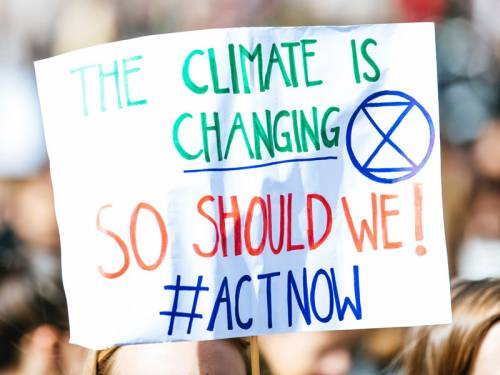 Sign that reads: The climate is changing. So should we! #Act Now.