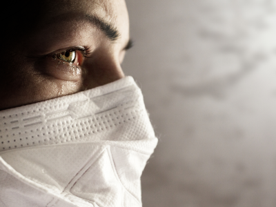 Teary-eyed woman wearing face mask