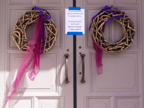"Church door with sign that says ""First Presbyterian Church is closed until Thursday, April 9. Please join us for services on Maundy Thursday, 5:30pm, April 9"""