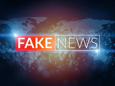 """Map of the world with the words """"Fake News"""" superimposed"""