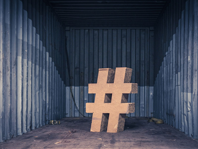 Giant hashtag made out of corrugated cardboard in a warehouse
