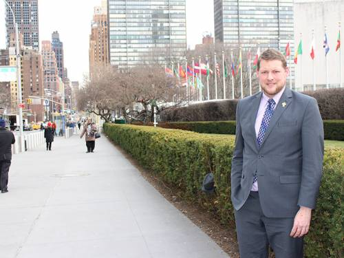 Ryan Smith outside the United Nations building in New York