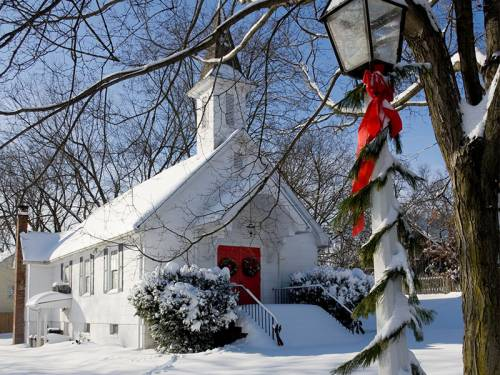 Snow-covered country church at Christmas