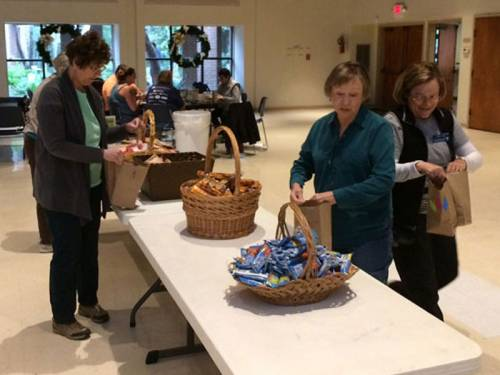 Church volunteers pack bags
