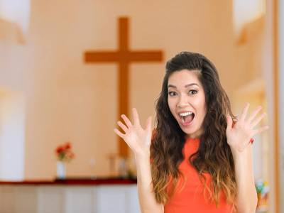 """Woman in church holding up """"jazz hands"""""""