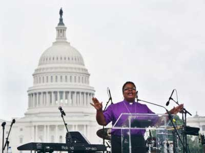 "United Methodist Bishop LaTrelle Easterling preaches during the ""United to Love"" rally in Washington, D.C., in opposition to the ""Unite the Right 2"" white supremacist demonstration on August 12, 2018."