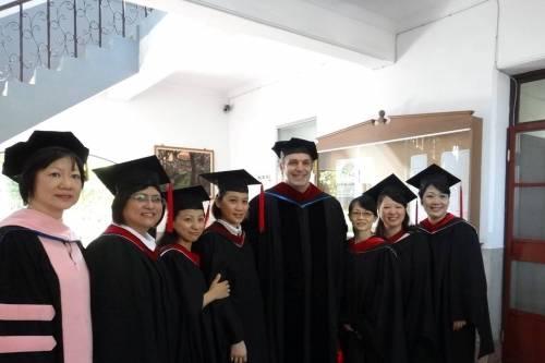 Jonathan with a group of graduating seniors and fellow teacher, Chen Shu-fen