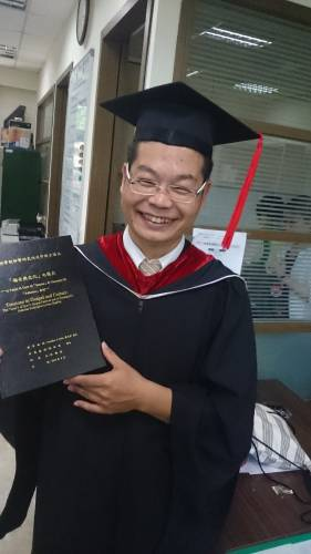 Wu Peng-tah, a student who wrote his thesis with Jonathan this year, holding the final project