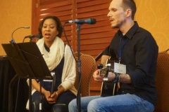 Ayana and Aaron Teter lead music during opening worship. (Photo by Emily Enders Odom)