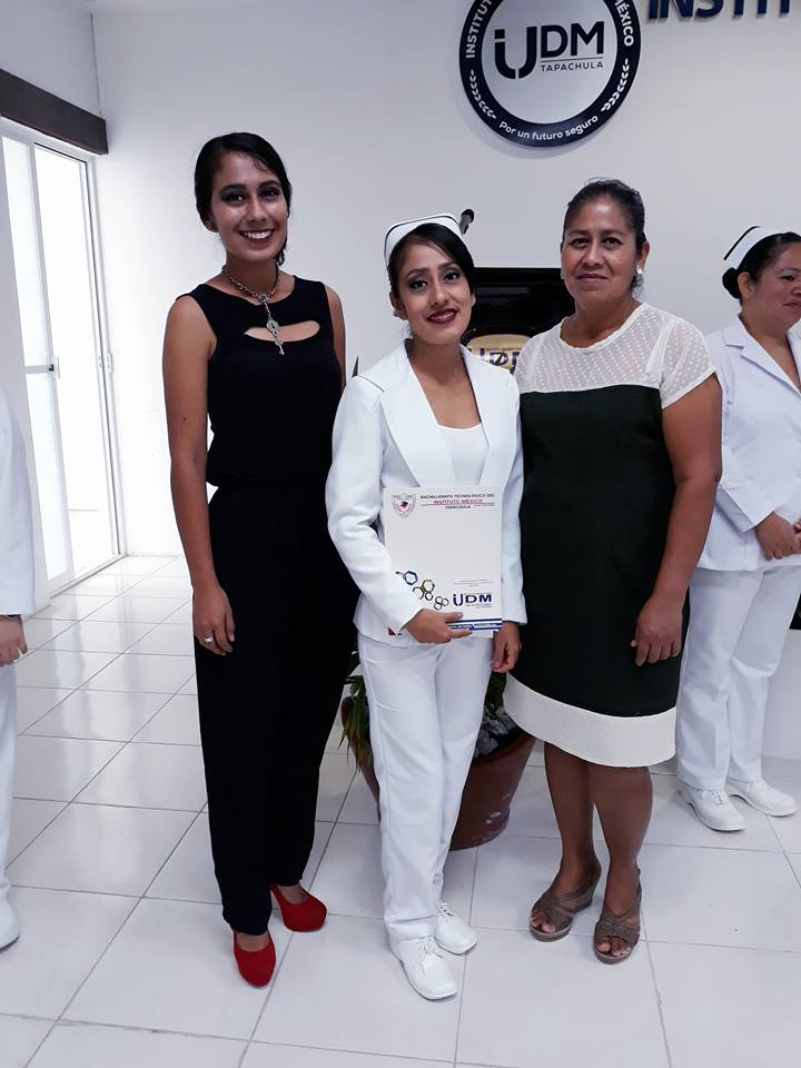 Madelin (center) at her graduation. With her mother, Ydelda, and her sister, Nilda.