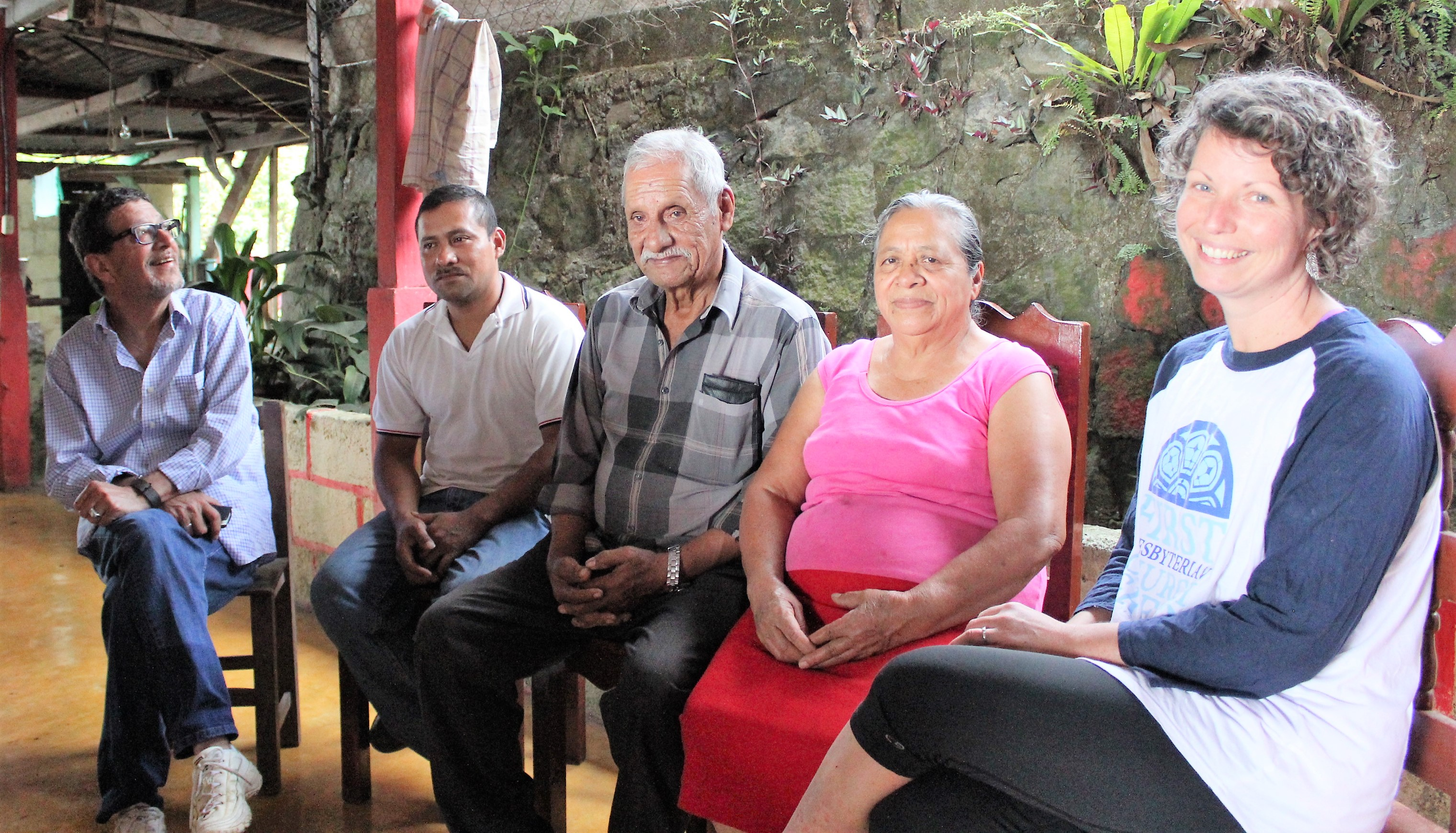 Don Bibiano Galvez receiving Border to Border Coffee, Migration and Faith delegation members in his home. From left to right: Conrad Rocha, Executive of the Synod of the Southwest; Don Bibiano's son Jose; Don Bibiano Galvez; his wife, Maria; and Ansley Wright of First Presbyterian Church Greer.