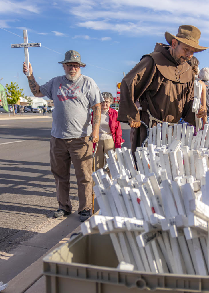 "Neil Novak behind the cart with the 313 crosses representing the persons who have died and been found in Cochise County since we as a nation have instituted the ""prevention through deterrence"" policy. (Photo: Eric O. Ledermann)"