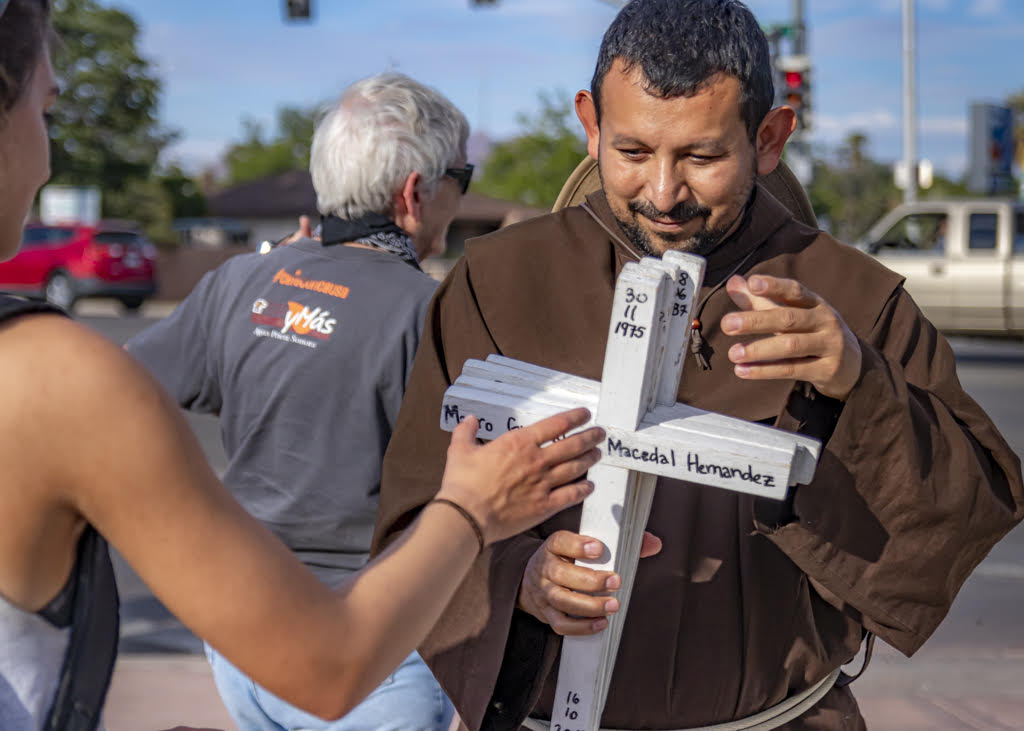 Brother Juan participating in the weekly Healing Our Borders Prayer Vigil. (Photo: Eric O. Ledermann)