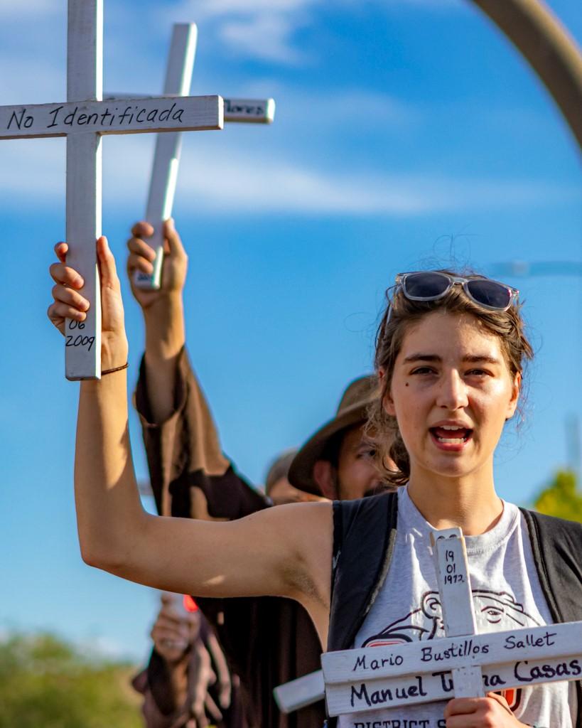 Elizabeth Nisly, FDC summer intern, participating in the weekly Healing Our Borders Prayer Vigil. (Photo: Eric O. Ledermann)