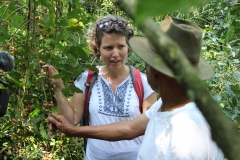 Ansley Wright learning about coffee cultivation from Don Jorge