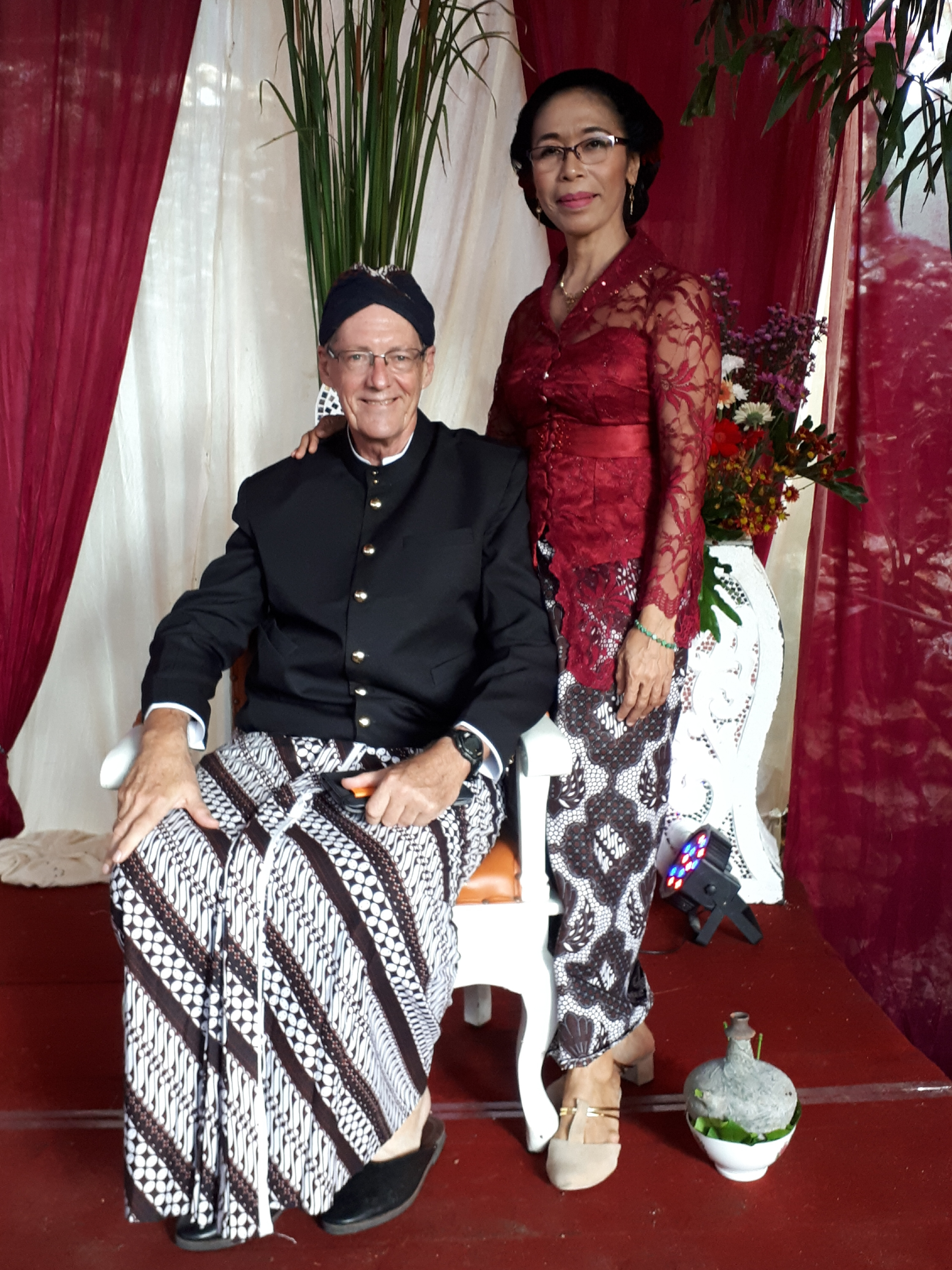 Farsijana and Bernie dressed like a Javanese king and queen.