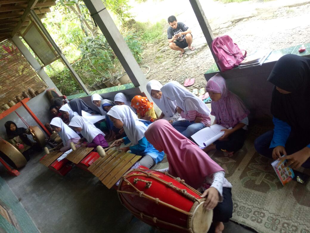 Making music on traditional musical instruments.