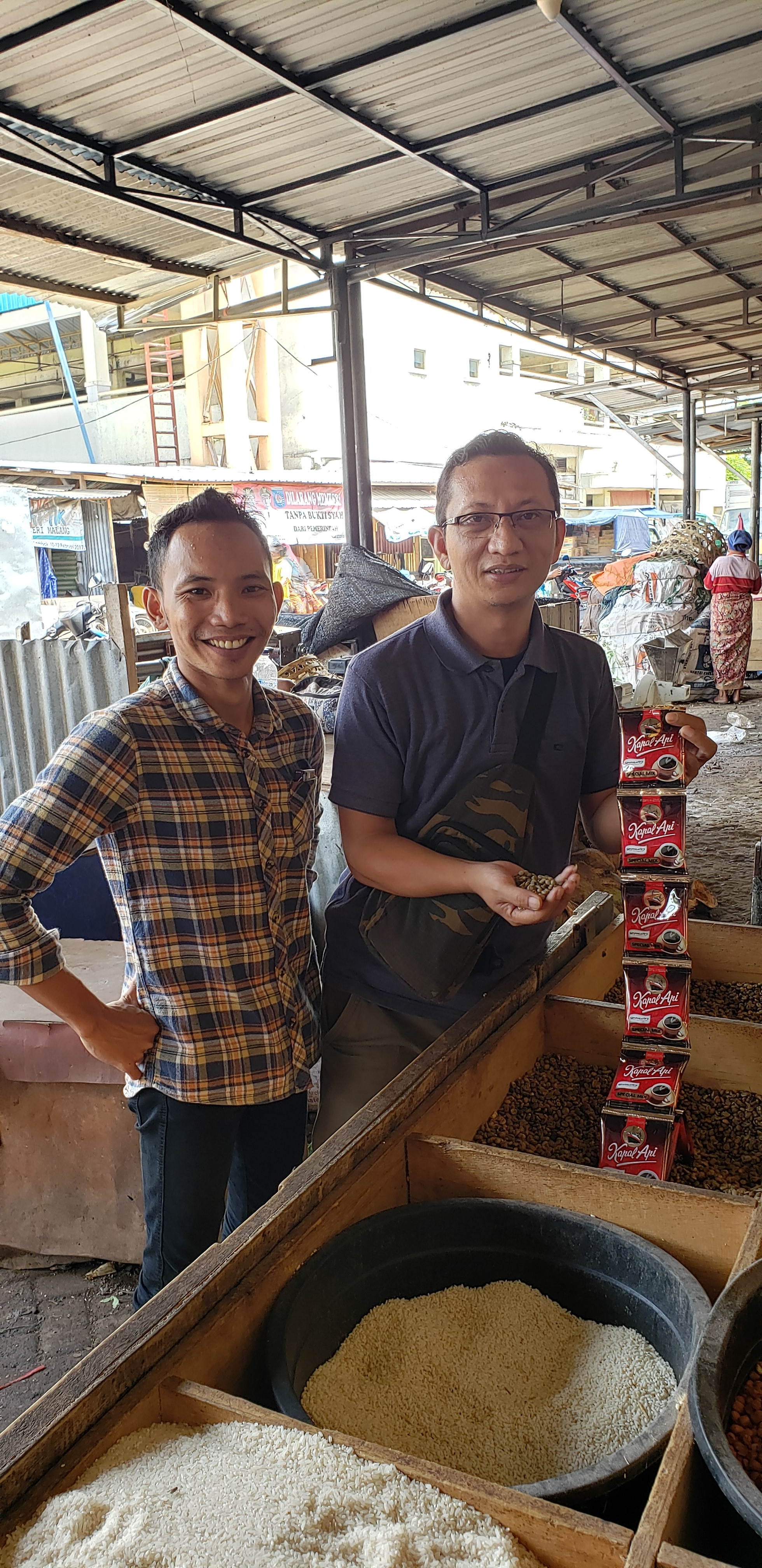 Roly (left) and Barmen with the coffee beans from West Lombok.