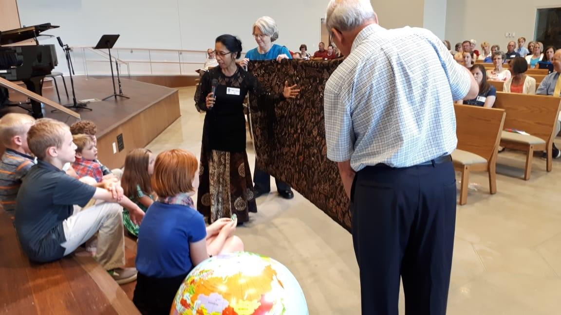 Farsijana speaks to children at St. Andrew Presbyterian Church in Iowa City.