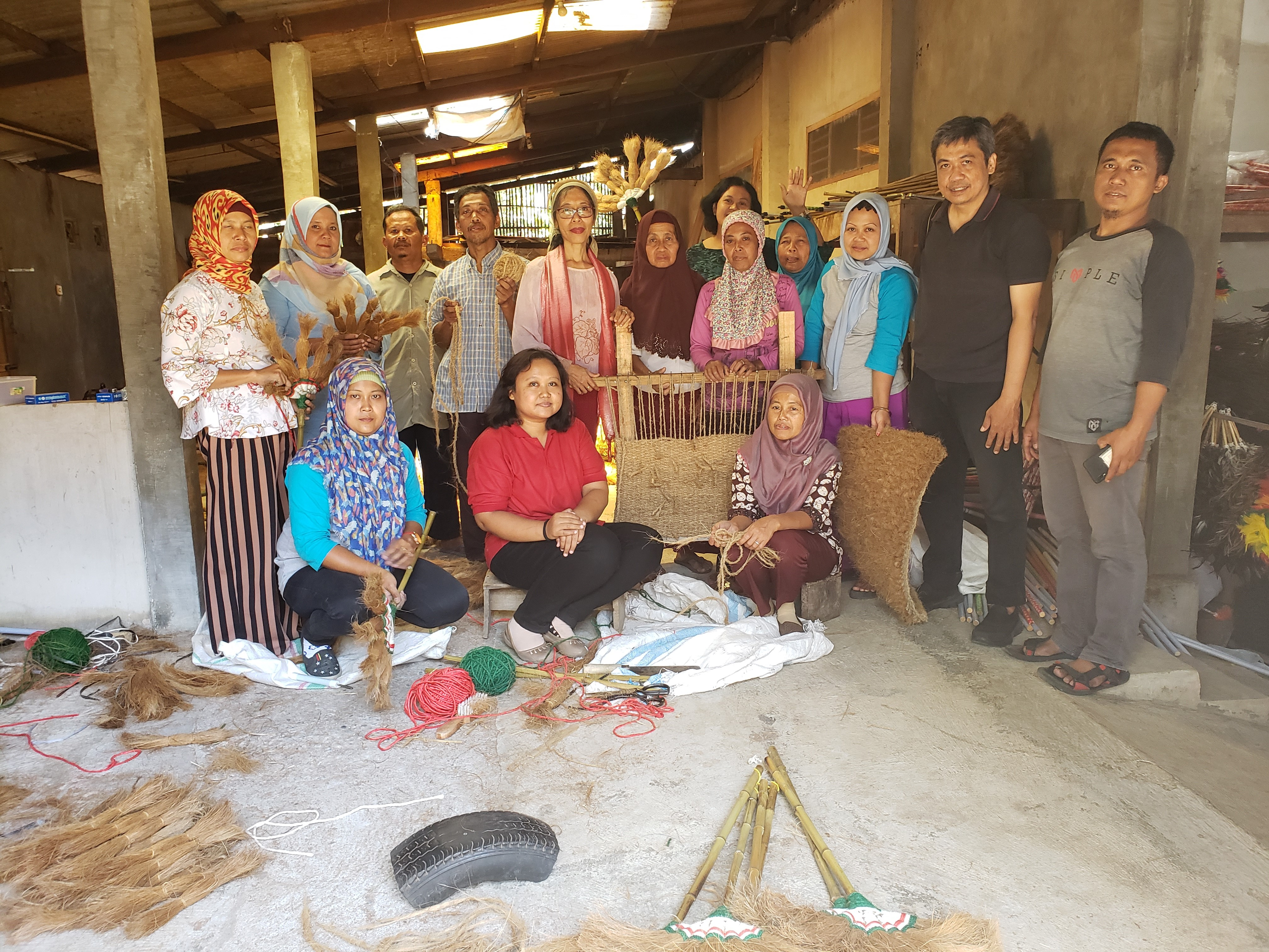 Muslims and Christians worked together at a workshop on making brooms, doormats and ropes from coconut fiber.