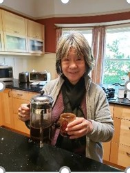 Sister Marda Strothers samples fair trade coffee, produced by House of Authentic Sense Cooperative in a batik Semar coffee mug.