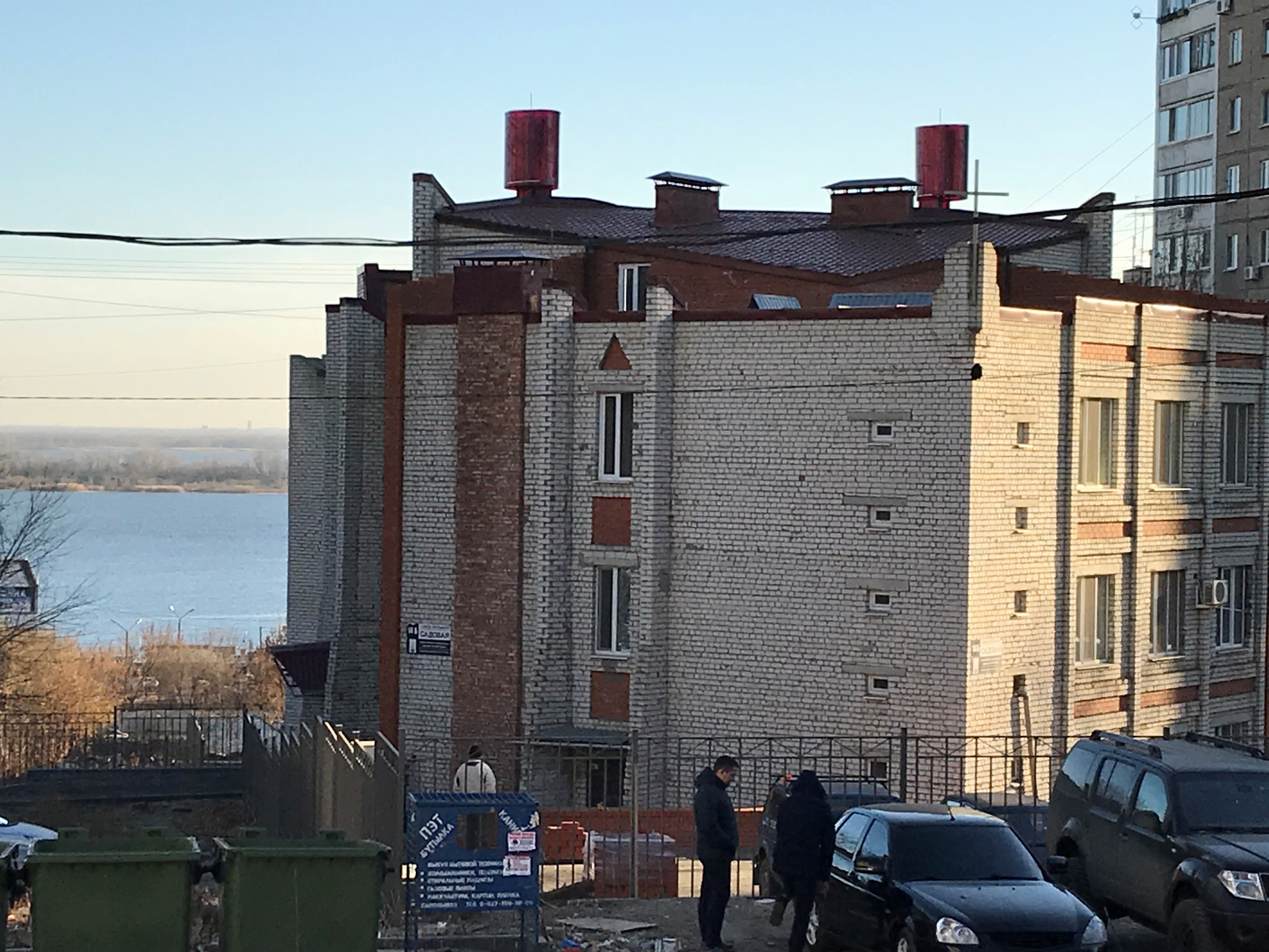The unfinished exterior of the sanctuary, with the Volga River in the background.