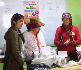 Urpi and Dr. Vicki teach nutrition and personal hygiene with Gabi translating.
