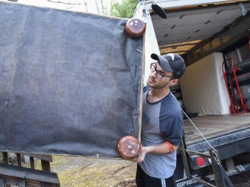 Jeremy Glidden helps a Homeward Bound client move in. (Photo by Gregg Brekke)