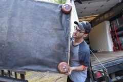 Jeremy Glidden helps a Homeward Bound client move in. (Photo by Gregg Brekke)