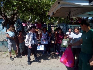 Families are happy to receive sugar, flour, oil, and sweets for the children.