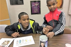 Abdissa and Arefat Ali, two brothers from Ethiopia and members of Westminster PC in Cedar Rapids, collecting pennies for PRODEK