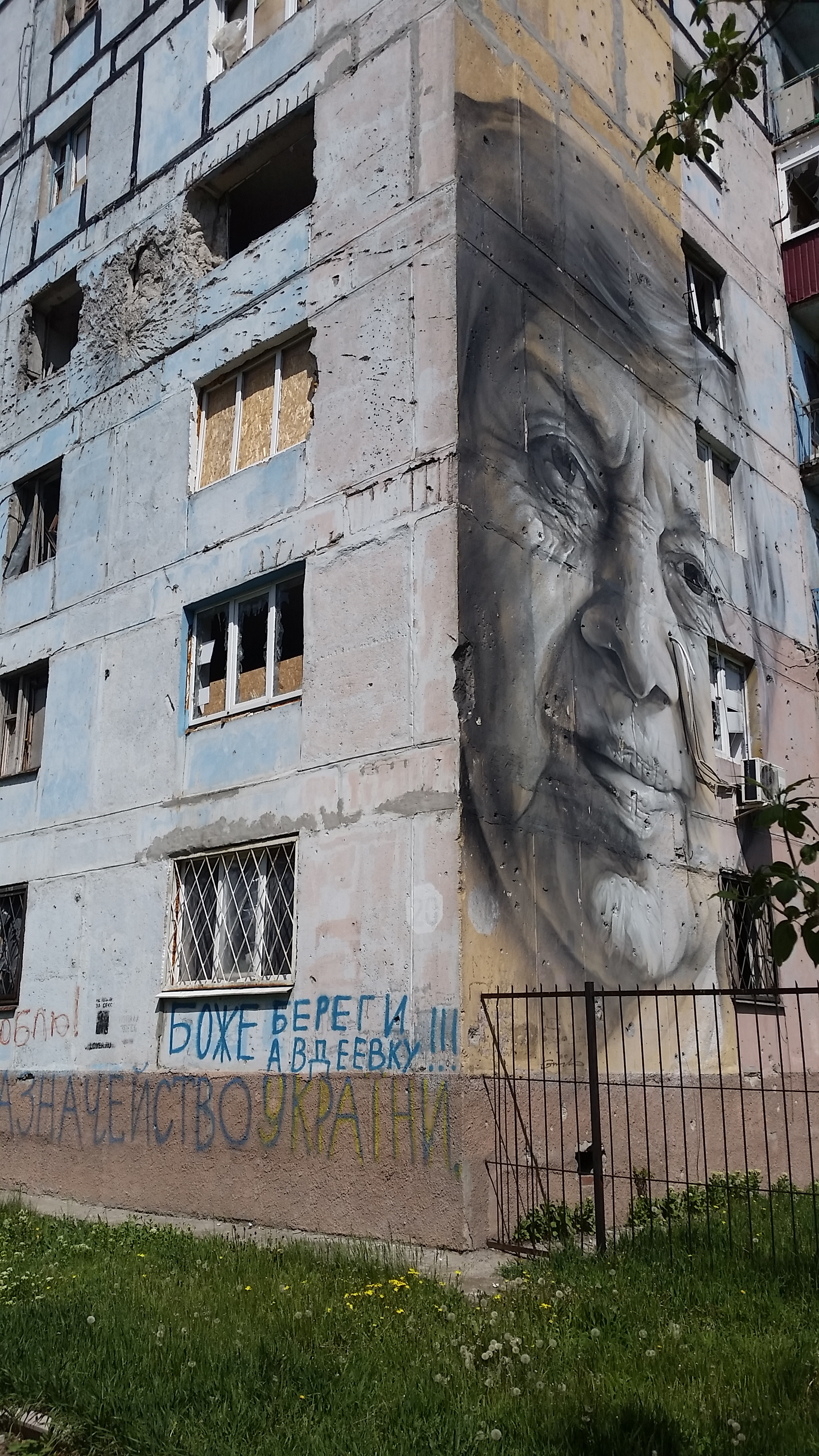 A mural protesting war in Eastern Ukraine by Guido van Helten.