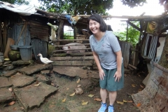On a recent visit to southern Philippines with staff from Presbyterian Disaster Assistance, mission co-worker Cathy Chang, regional facilitator for addressing migration and human trafficking in Southeast Asia, enjoys a lighthearted moment with a healthy pig. Photo credit: Laurie Kraus