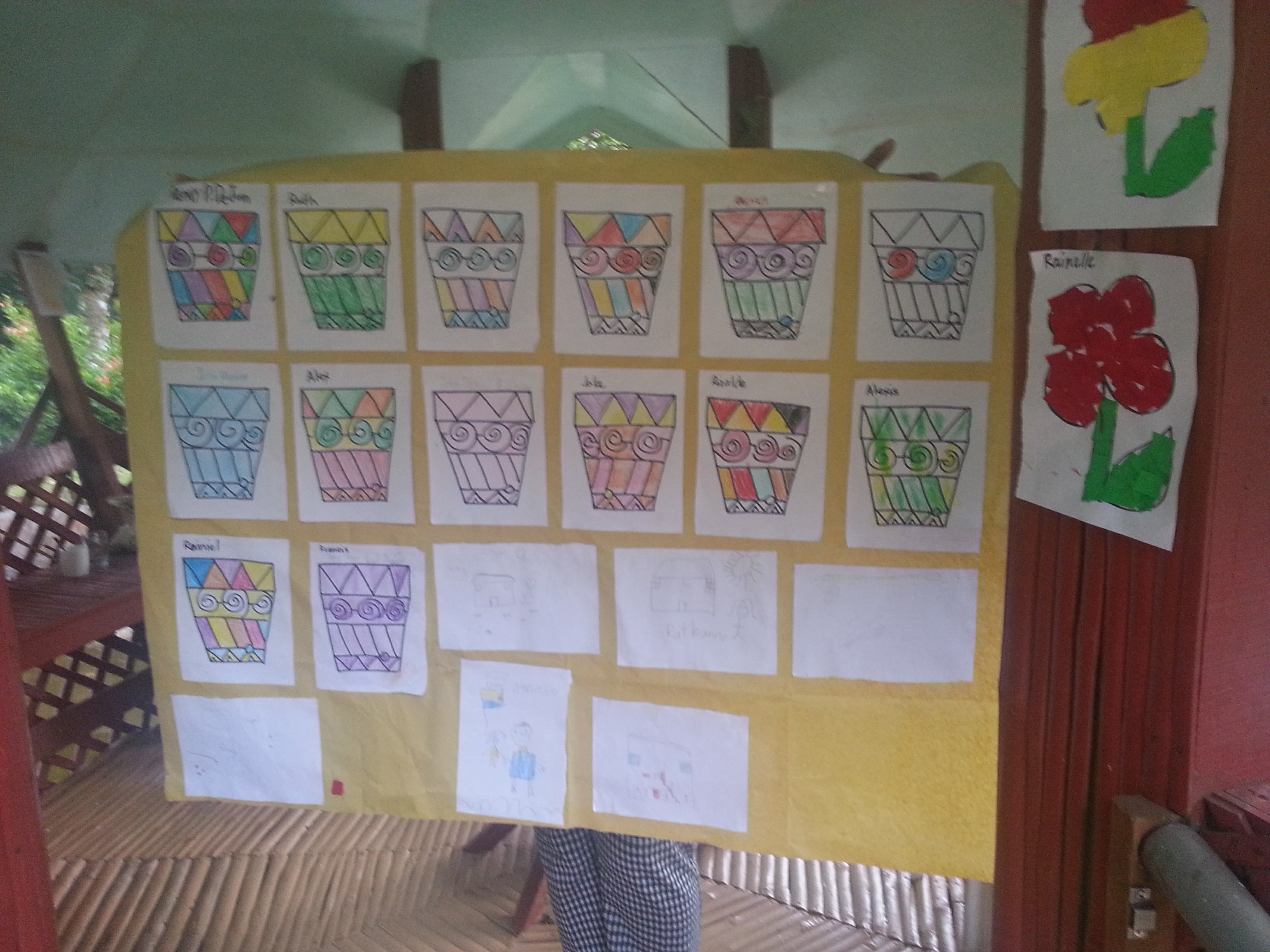 Exhibiting artwork from the kinder-kids at Kaisummer Camp.