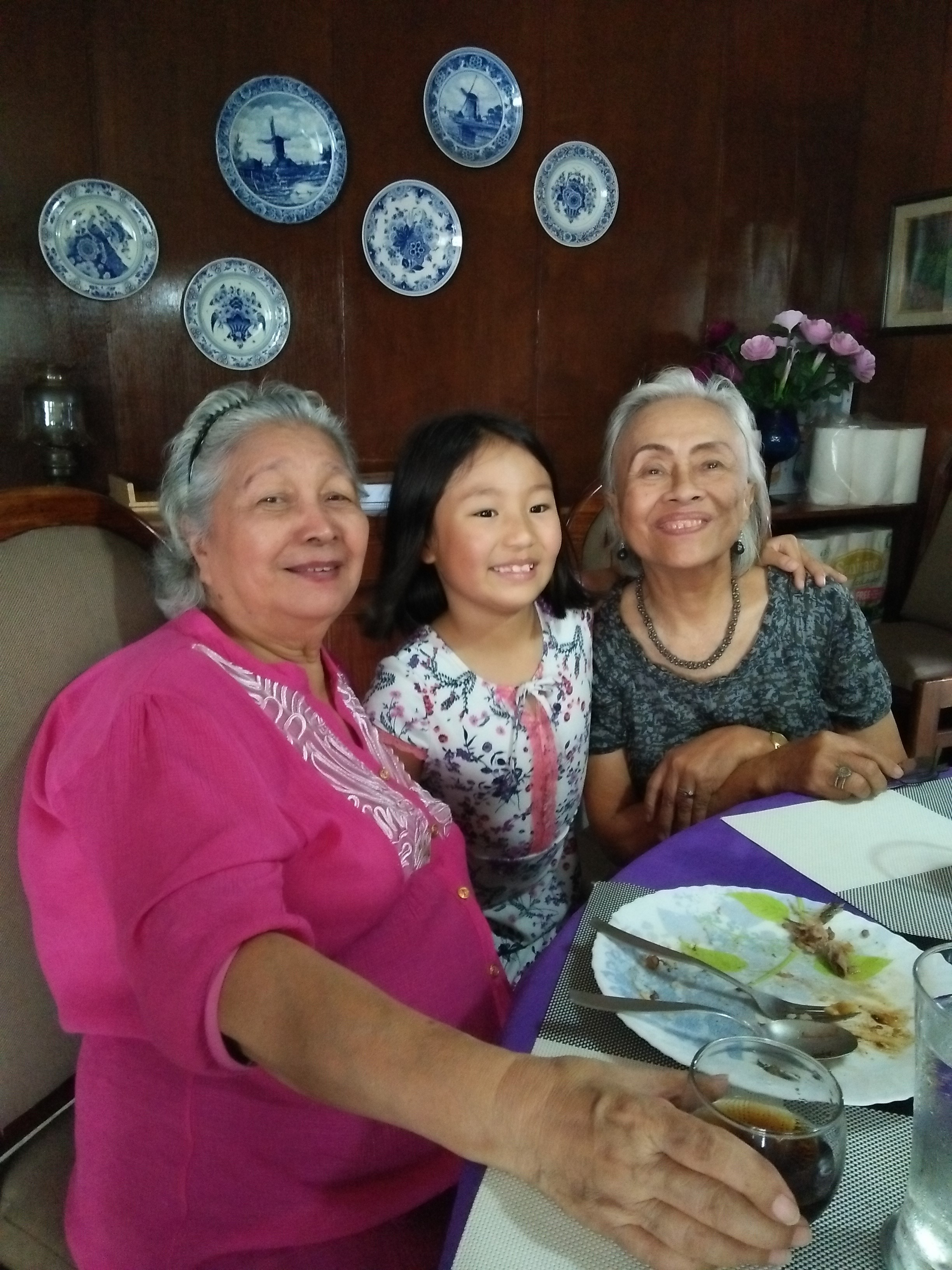 Aurelie enjoying lunch with Lola Alice (in pink) and Lola Mimi (in grey).