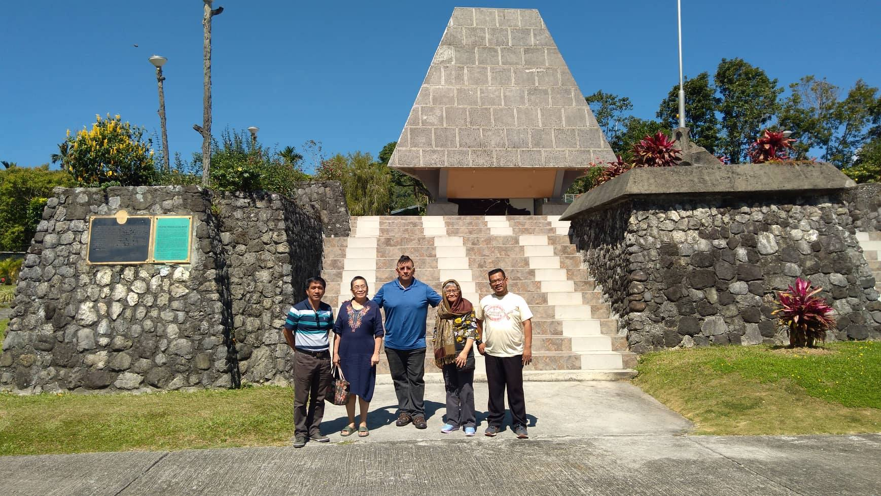 At the WWII memorial in Ifugao. From left to right: Pastor Ruben Pugudon, Ma'am Edna Orteza, Juan Lopez, Dr. Ruth De Lara and Jason Carperas.