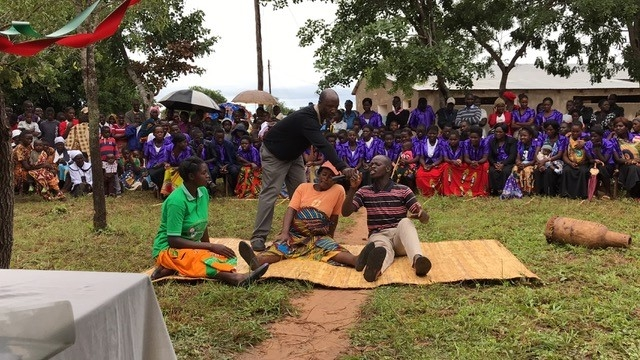 The Safe Motherhood Action Group (SMAG) puts on a skit about the importance of coming to the Egichikeni Rural Health Center for a safe delivery.