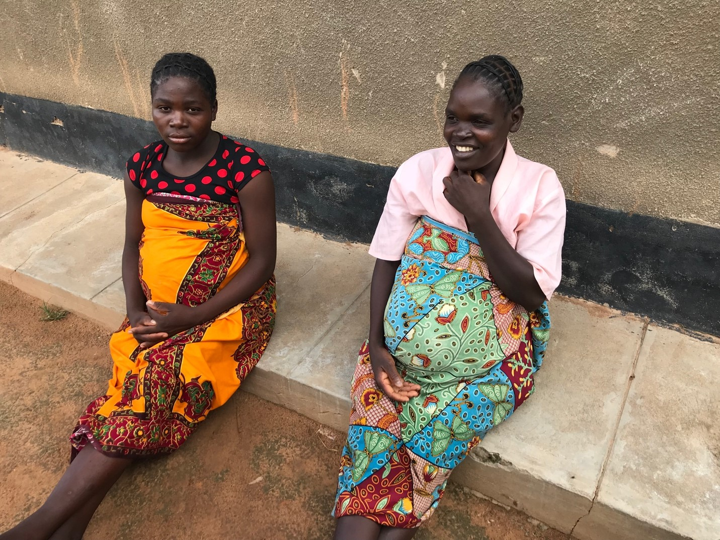 Two of the many women waiting to give birth at the Egichikeni Rural Health Center.