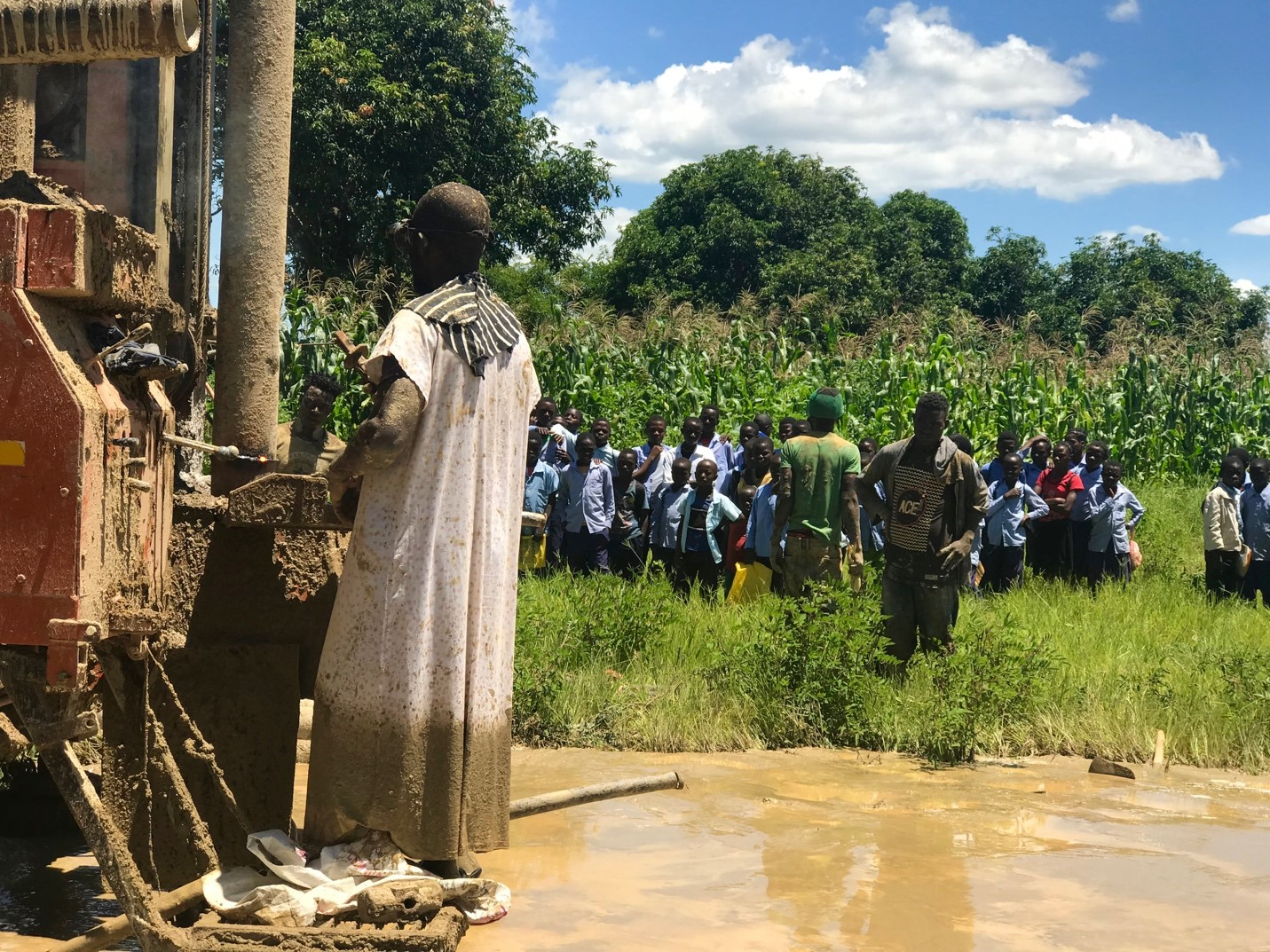 When school was out, all the Phalaza community kids came to watch the drilling of the new borehole.