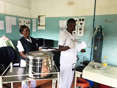 Dorian Willima and Martha Banda, nurses who will be training and screening women for cervical cancer during the CCAP Cervical Cancer Program, show off their screening facility at the Lundazi District Hospital.