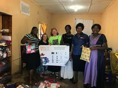 Martha Sherrod and Patricia Clark, mission team members from Northwood Presbyterian Church, San Antonio, present supplies to the women of the CCAP Health Department Days for Girls Enterprise.