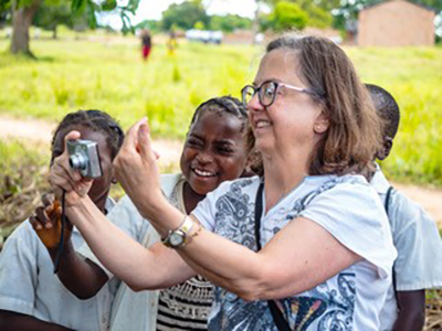 During the Chasefu AIGA Agricultural Storage Facility groundbreaking ceremony, mission team visitor Martha Sherrod makes some new friends.