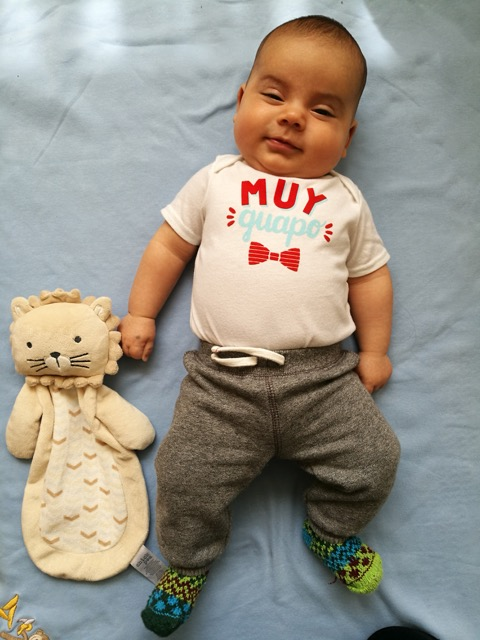 "Leandro celebrating his three-month birthday. His onesie says ""Very Handsome."""