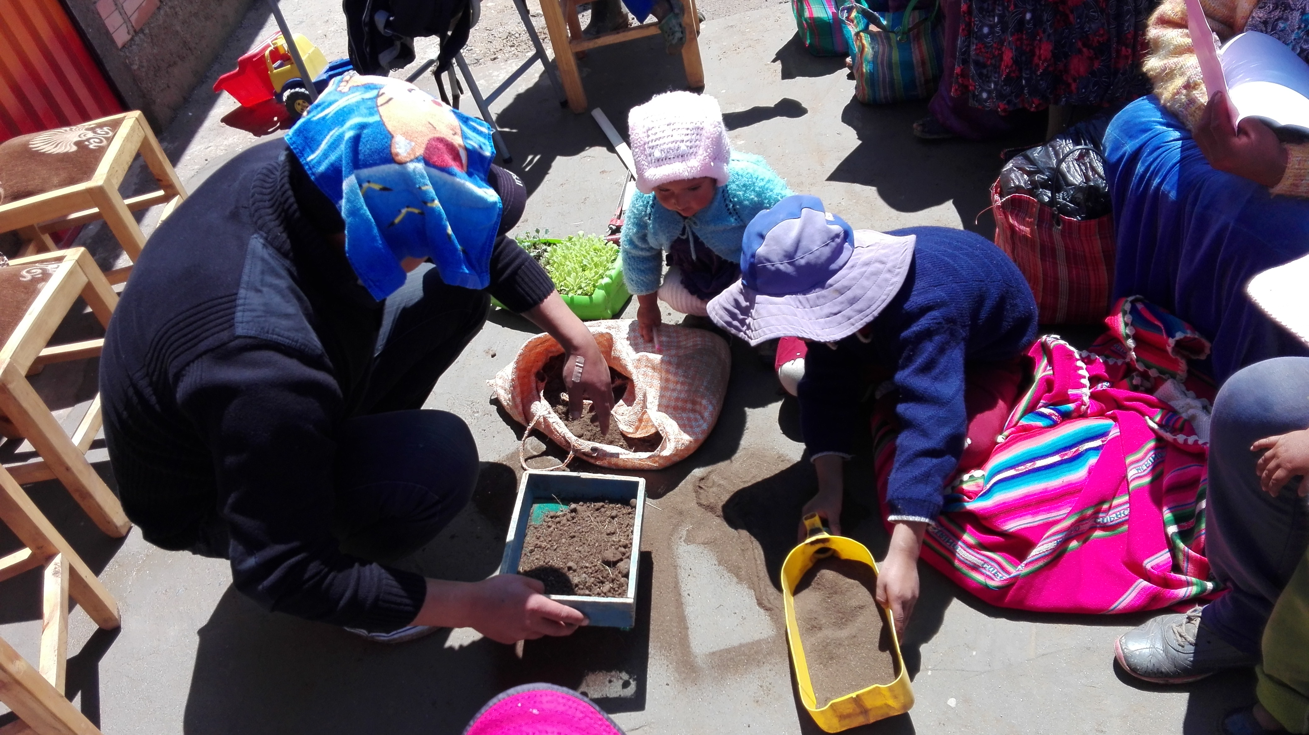 Teaching the next generation about the importance of growing and caring for organic crops, El Alto, Bolivia.