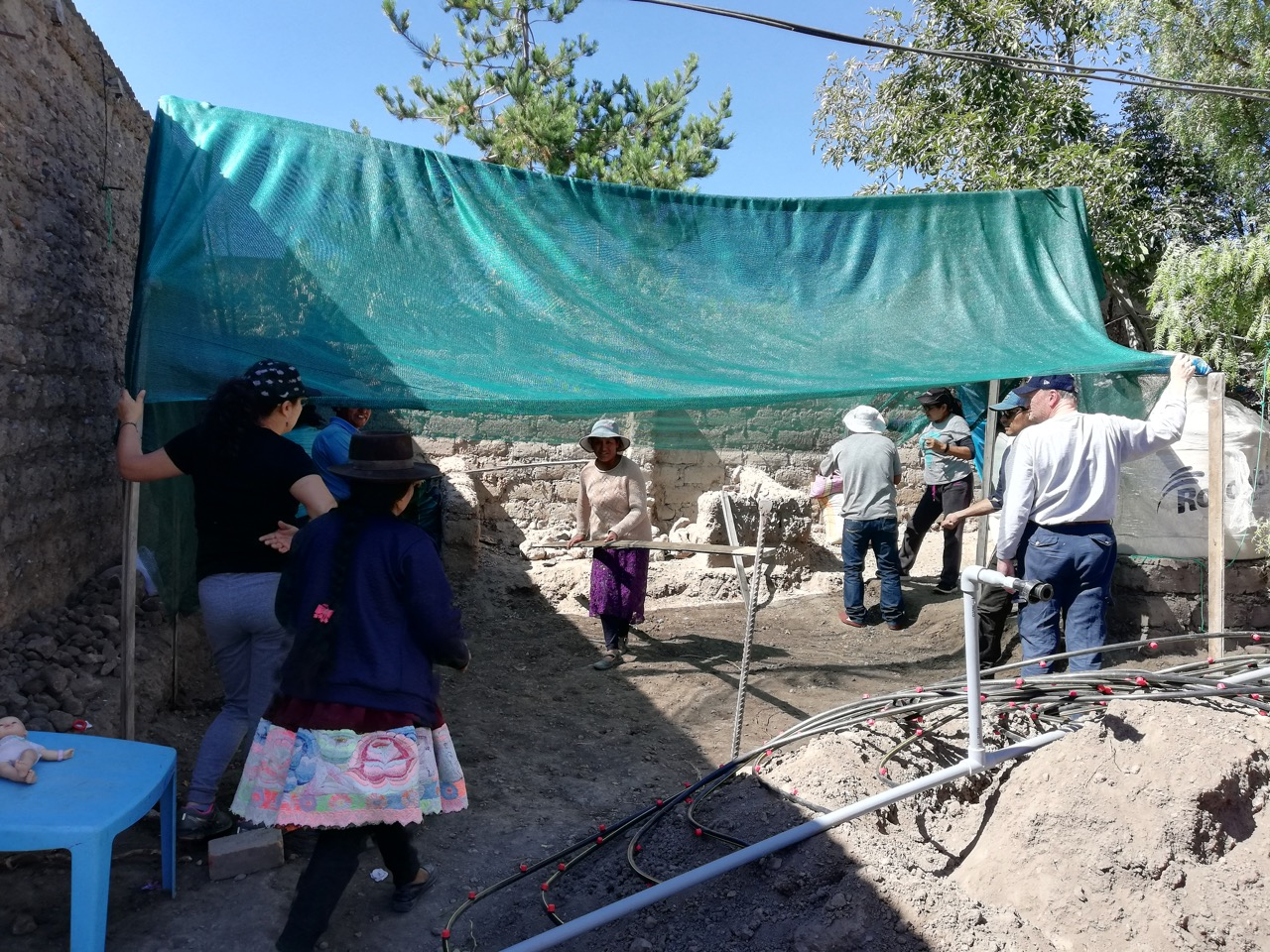 Sharon PC delegation constructing a family garden roof with community women in Yanama, Peru.