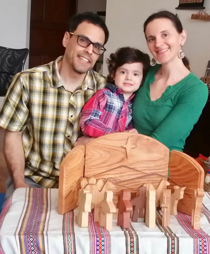 Family Christmas Photo with nativity scene