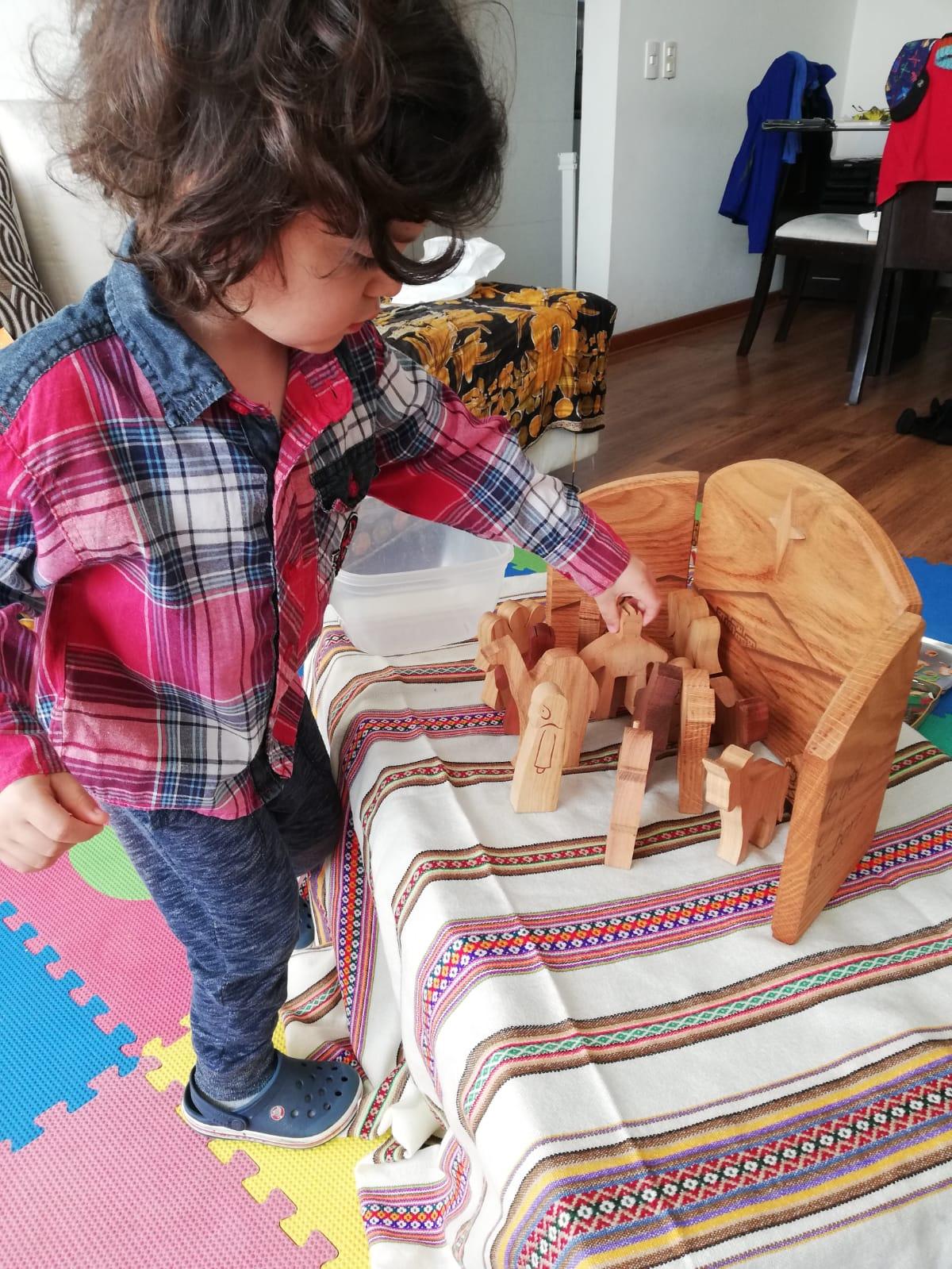 Leandro sets up the nativity scene