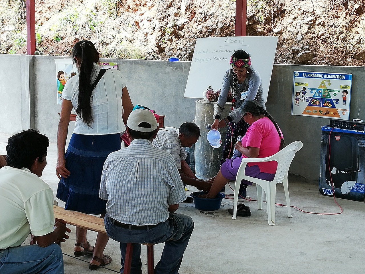 Urpi leads a class for those in the waiting area to learn about, not only hygiene, but humility as well. San Martín, Peru