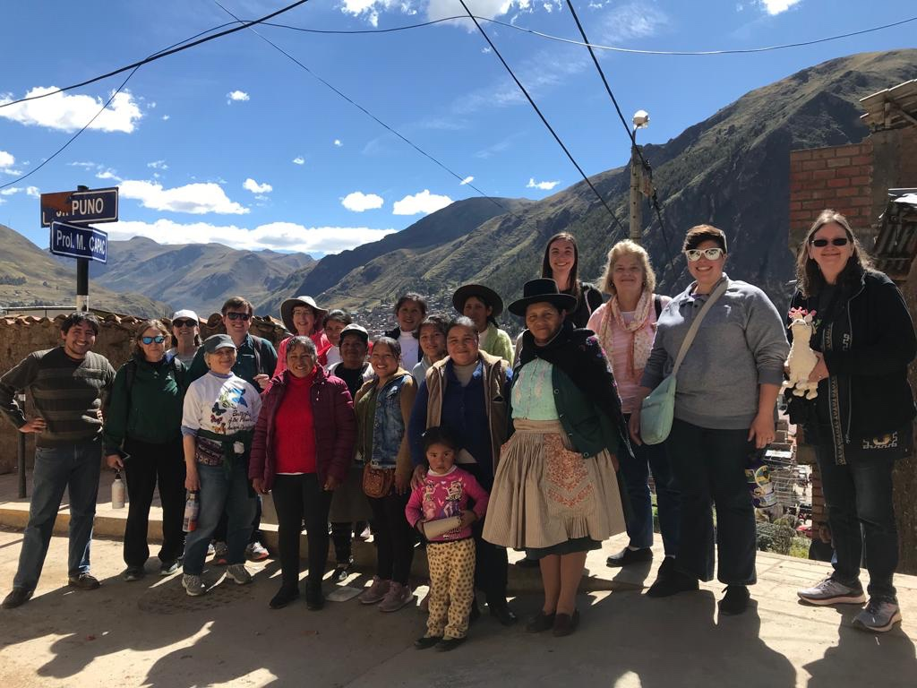Joining Hands delegation visiting with the artisan group El Mercurio. Huancavelica, Peru